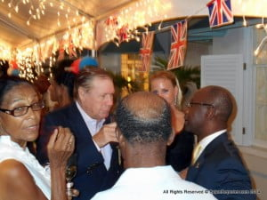 "The caucasian dude about to sip is Ralph ""Bruggadung"" Johnson, noted Yachtsman and CEO of Harris Paints, he & his spouse are chatting with Sports Minister Stephen Lashley at extreme right"