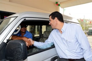 Maurico Nicholls greeting Brian Hadaway one of the Peruvian Vale's station's first customers