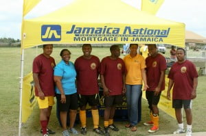 Wolmer's - The winners of the 6v6 soccer tournament with their sponsor, Jamaica National Building Society.
