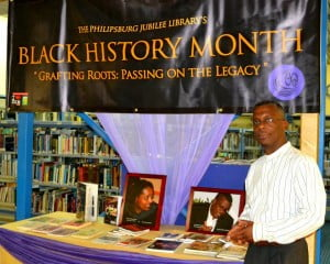 Publisher Lasana M. Sekou invited by Philipsburg Jubilee Library to view exhibit of St. Martin books in February 2014. (PJL photo)