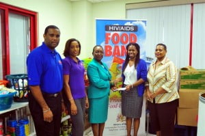 From left to right: Marketing Officer, Ronny Yearwood, Acting Chief Information Officer of BGIS, Sharon Lynch, and Chairman of the Internal HIV Committee of BGIS, Lisa Bayley presenting the cheque to Manager of the HIV Food Bank, Stacia Whittaker and Nurse Manager of the Ladymeade Reference Unit, Eleanor Blackett.