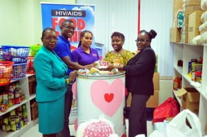 Acting Chief Information Officer of the BGIS, Sharon Lynch, and Internal HIV Committee members: Jamal Hall and Shamkoe Pilé, presented the Love Poetry and Song food donation to representatives of the BPW Shelter for Victims of Domestic Abuse, Marissa Hutchinson and Sonia Clement Stuart.