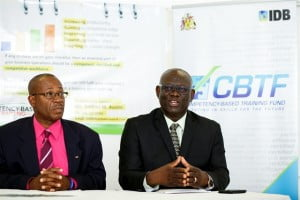 Manager of the Competency-Based Training Fund (CBTF) Management Unit, Anderson Lowe (right) announces the Call for Proposal while Executive Director of the TVET Council, Henderson Eastmond listens.