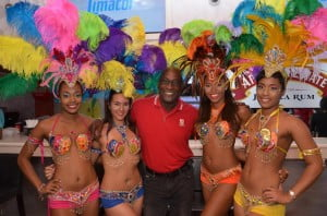 West Indies legend and Antigua Hawksbills Team Mentor, Sir Viv Richards, surrounded by the lovely ladies at the CPL 2014 Draft