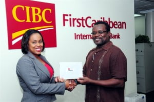 Krystle Maynard, Senior Dealer, Foreign Exchange & Money Markets, CIBC FirstCaribbean presents Colbert Ashby, President of BARNOD with funds to assist the organisation in its work.