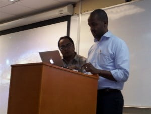 Dr Kenfield Griffith, CEO, mSurvey and Anil Ramnanan, PhD student at The University of the West Indies (UWI) Department of Computer Studies, at mSurvey's workshop on Data Collection and Surveying using Mobile Technology, held at the Max Richards Building, Faculty of Engineering , UWI St Augustine on March 28, 2014. PHOTO: GERARD BEST
