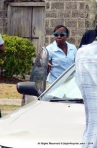 This is the NCC's Human Resources Officer warning away Media as she arrives to work, she declined to offer any words to journalists other than she has no comment at this time.