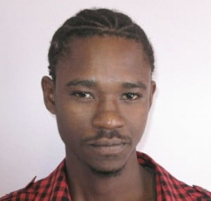 Shane Hakeem Omar Babb, alias 'Velt' or 'Nasty', 22 years of Fryers Well, Checker Hall, St Lucy.  He presented himself at a police station on Friday 2 May 2014 accompanied by a family member.