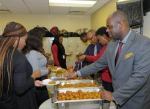 Branch Manager of Warrens Banking Centre Richard Kennedy leads the way in serving breakfast to some of his staff members.