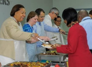 Members of the Senior Executive Team of CIBC First Caribbean (left to right) Ella Hoyos, Colette Delaney, Trevor Torzsas, Geoff Scott and Brian Lee as they served breakfast to members of staff at the bank's regional headquarters, Warrens last Thursday.