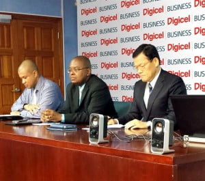 Representatives of the Government of St. Lucia officially sign the contract with Digicel's Head of Business Development (OECS South), Keigan Cox (left).