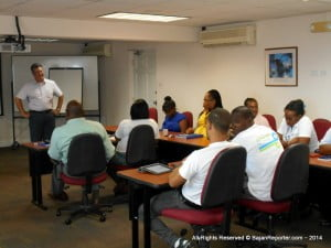 The class was held at the First Caribbean suite near the Student Guild at UWI. Frank at the front of the room has a chuckle while explaining some details to eager and attentive Flow employees