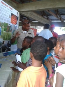 Technician Dexter Adams explains the Farm to Fork display to students