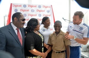 Digicel Academy 2013 MVP, Cadine Graham, is congratulated by the Honourable Minister, Natalie Neita Headley, the President of the Jamaica Football Federation, Captain Horace Burrell, Digicel Kick Start Head Coach, David Monk and Digicel Jamaica Sponsorship Manager, Tahnida Nunes on receiving a scholarship to attend the University of the West Indies in Barbados as a result of the Digicel Kick Start programme.