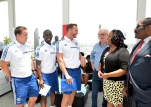Sports Minister Natalie Neita Headley shares a joke with the coaches from the Chelsea FC Foundation, David Monk, Kobina Elliot and Andrew Ottley, at Digicel's Regional Headquarters in Jamaica
