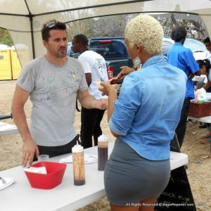 Scott Ames did Black Belly Lamb in Jerk Seasoning style and ran out of food by 1:00 pm, here he is explaining to a patron that sunny day...