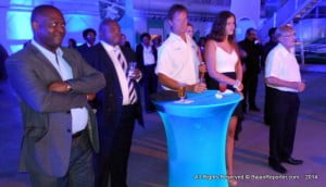 """(From Left) Int'l Business Min. Donville Inniss, Flow's Rory Hunte, Popular Rally Driver Paul """"The Surfer"""" Bourne & Companion(s)"""