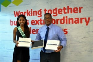 Commercial Director for Digicel (Barbados) Limited, Alex Tasker (right) makes the presentation of the three iPads to Miss Barbados World delegate, Samantha Gittens.