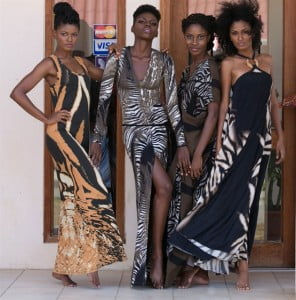 KajFAB models strike a pose in front of the Kaj Flagship Boutique.  From left to right: Fertility tank dress; long sleeved evening dress; silk kaftan; and maxi dress with ring accent. Makeup by Lyndy-Anne Parks of Gloss Productions.