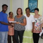 BJS Pres. Ann Smith and Board Members presents a cheque to Stefan Walcottleft