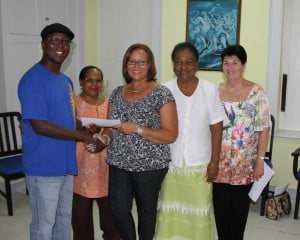 BJS Pres. Ann Smith and Board Members presents a cheque to Stefan Walcott (left)