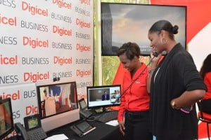 Marketing Executive for Digicel Business, Shakida Grant, demonstrates the Cisco Collaboration solution to LIAT Marketing Executive, Risha Daniel