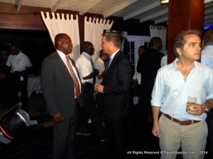 An avid supporter of the Internet, MP Donville Inniss (in tie) chats with FLOW Barbados' Managing Director,  (black suit) Niall Sheehy