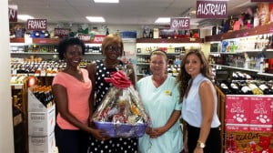 From L-R: Marita Greenidge, Brand Manager of Red Cat Wine, Jalisa Seale, winner of Red Cat Wine Hug Your Cat 2014 Promotion, Cornelia Coultherust, Founder of The Hope Sanctuary, Sacha Cabral, Retail Director of Wine World Inc.