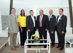 Managing Director, Cayman Islands, Mark McIntyre (4th from left); & Managing Director, Private Wealth Management (PWM), Dan Wright (left) are joined by other members of the Cayman Islands PWM team.