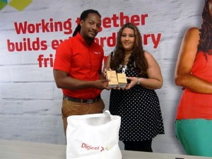 Week 1 Winner Takes Home Gold Samsung Galaxy S5 and a Samsung Galaxy Gear Fit watch - Rebecca Fernandes (right), collecting from Digicel Marketing Executive, Marc Massiah
