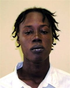 "He is Scott Colby Harewood, 28 years, alias ""Rat"" or ""Ratty"", last known address Castle Heights, St. Philip.  He is about 6' 1"" in height, slim build, of black complexion, has dark brown eyes and thick dark lips.  He has tattoos of a gun on left forearm, and ""50 Niggaz"" on his right bicep."
