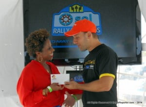 Paulette Jones' name was drawn and she got to exchange grins with Ryan Haloute of Chefette Restaurants