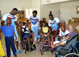 (Left to Right) West Indies players Kemar Roach, Kirk Edwards, Jason Holder and Kraigg Brathwaite interacting with a few of the residents recently at the Violet Gittens Special Unit of the Nightengale Children's Home.