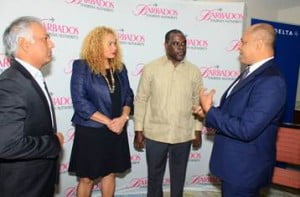 R to L: Richard Pile, District Sales Manager, Delta Air Lines, chats with Barbados Tourism Authority's (BTA) Chairman, Adrian Elcock; BTA's Interim President and CEO, Petra Roach; and Barbados Hotel & Tourism Association's (BHTA) President, Sunil Chatrani after the just concluded press conference launching the recommencement of a Delta Air Lines' Barbados service.