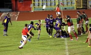 3. Bdos Mexico Iestyn kicking – Iestyn Caddy kicks the ball downfield after Barbados won the scrum