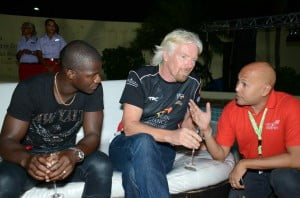 L to R: Darren Sammy, Sir Richard Branson, President Virgin Atlantic and Andre Bello chatting at the 2013 CPL tournament.