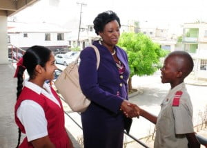 Rhonda Howell, Human Resources Manager, HIPAC Ltd. is thanked for her presentation by Rommell Hunte, Deputy Head Boy and Britney Ramotar, Head Girl.