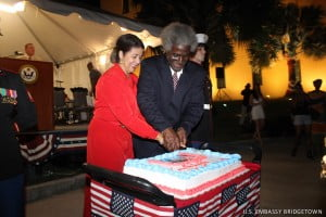 U.S. Ambassador Dr. Larry Palmer and his wife, Mrs. Lucille Palmer, cut the Independence Day cake.