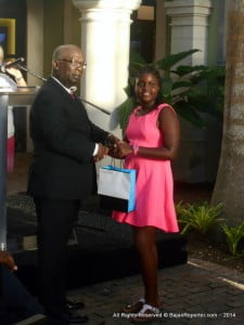 Over the years, the Charles F. Broomes primary continues to produce top performers for the Barbados Secondary Schools Exam known as the '11+', here is another pupil from that institute: Jamie Lynn Gibson, collecting her Diamonds Int'l gift from Ronald Jones, Minister of Education at Limegrove in Holetown