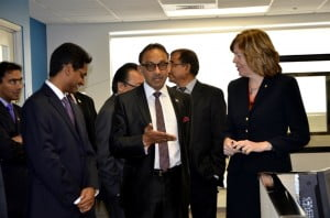 Senator Bharath interacts with Ms Schnoor of Scotiabank while on tour