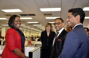 Minister Bharath in conversation with a member of staff of OSSCL, with Ms. Schnoor and Mr. Sebarath