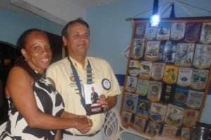 Dr. Rhoda Arrindell (L) presents Mid-Isle Rotary Club President Wayne Wilkie with a copy of her new book, Language, Culture, and Identity in St. Martin.