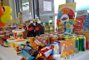 KEEPING IT LOCAL? A range of Barbadian-made food items were collected by staff and customers of the Scotiabank Broad Street branch to be donated to the HIV/AIDS Food Bank. The food drive was part of the branch's NISE 100 improvements challenge.