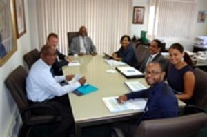 Minister of Justice, Dennis Richardson (at head of table) chairs the meeting. Clockwise are: Regina LaBega, SXM managing director, Udo Aron, Sec.-Gen. Ministry of Justice, Mrs. Migdala Artsen-Clarinda, Robert Brown, and Larry Donker all of SXM Management Team and Ron van der Veer of the Ministry of Justice. (SXM photo)