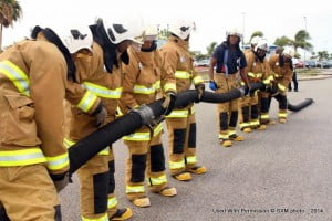 SXM Airport firemen attending to fire hose sections during the public demonstration at the airport for Firemen's Week 2014. (SXM photo)