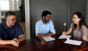 From left: James Burke, Caribbean Team Researcher, Amnesty International; Jonathan Ali, Editorial Director, trinidad+tobago film festival; and Chiara Sangiorgio, Campaigner – Global Thematic Programme, Amnesty International share a joke at the ttff's offices while signing the memorandum of agreement to establish the Amnesty International Human Rights Prize