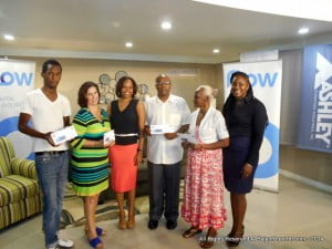 L to R - (Final Weekly Winners) Temar Alleyne, Ellie Brown, FLOW's Corp. Comm's Mgr: Tracy Moore, Shirland Clarke, Felicia Bostic and Courts Unicomer's new Mktg Mgr Arlene Floro