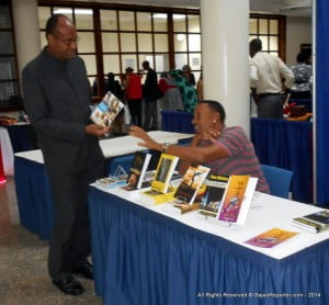 Former City MP Patrick Todd purchasing from a literary vendor