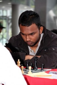 Trinidad and Tobago Junior Chess Champion, Vishnu Singh, in deep concentration during his first round game during the Caribbean Chess Carnival at NAPA