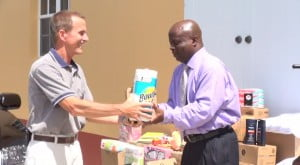 (L-R) Dennis Thomas hands over donation for inmates at the Prison Farm to Permanent Secretary in the Premier's Ministry Wakely Daniel on 07th August 2014